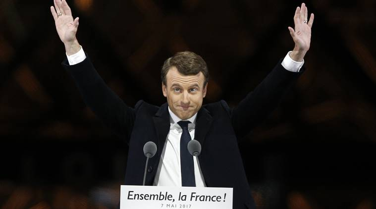 French+President-elect+Emmanuel+Macron+gestures+during+a+victory+celebration+outside+the+Louvre+museum+in+Paris%2C+France%2C+Sunday%2C+May+7%2C+2017.+Speaking+to+thousands+of+supporters+from+the+Louvre+Museum%27s+courtyard%2C+Macron+said+that+France+is+facing+an+%22immense+task%22+to+rebuild+European+unity%2C+fix+the+economy+and+ensure+security+against+extremist+threats.+%28AP+Photo%2FThibault+Camus%29