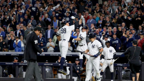 NEW YORK, NY - OCTOBER 03:  Aaron Judge #99 of the New York Yankees celebrates with teammate Brett Gardner #11 after hitting a two run home run against Jose Berrios #17 of the Minnesota Twins during the fourth inning in the American League Wild Card Game at Yankee Stadium on October 3, 2017 in the Bronx borough of New York City.  (Photo by Al Bello/Getty Images)