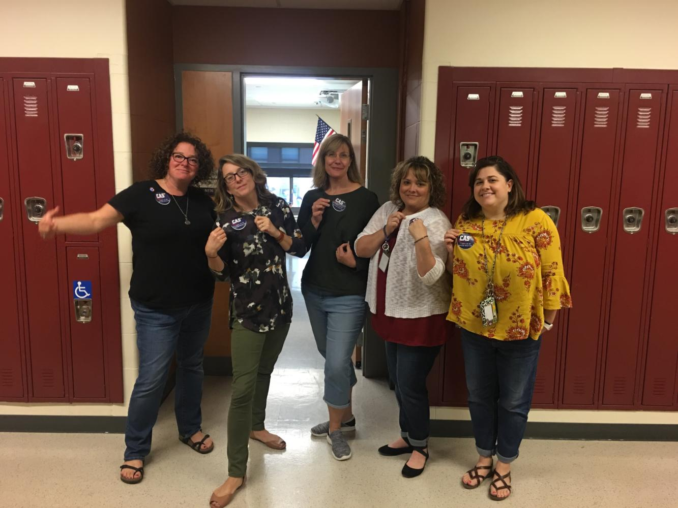 Mrs. Brennan, in charge of the hurricane fundraiser, poses with dressed down English teachers Mrs. Walsh, Ms. Norcross, Mrs. Dymond and Mrs. Dunn
