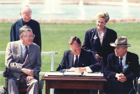 President George H.W. Bush signs the ADA - 1990.