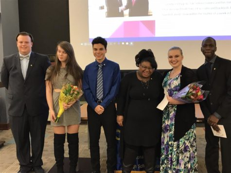 Eight students are inducted into Quill and Scroll