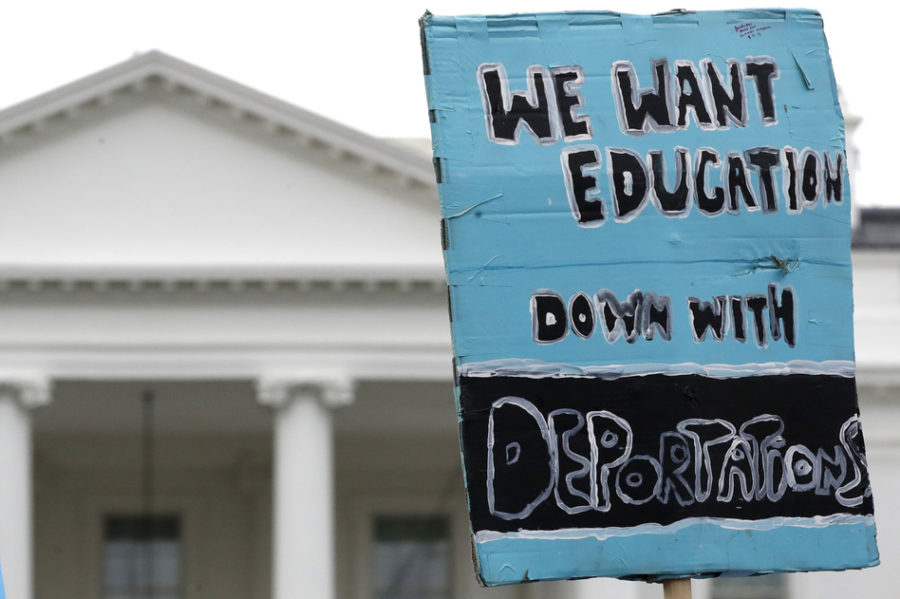 A sign is held up by the White House in support of the DREAMers and the Deferred Action for Childhood Arrivals (DACA) program, on Sept. 5, when Attorney General Jeff Sessions announced the Trump administration will
