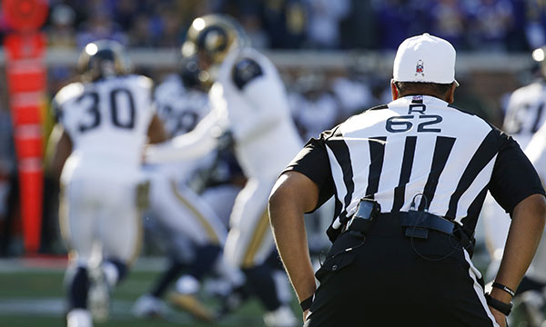 Referee Ronald Torbert (62) looks over the play during the first half of an NFL football game between the Minnesota Vikings and the St. Louis Rams, Sunday, Nov. 8, 2015, in Minneapolis. (AP Photo/Ann Heisenfelt)