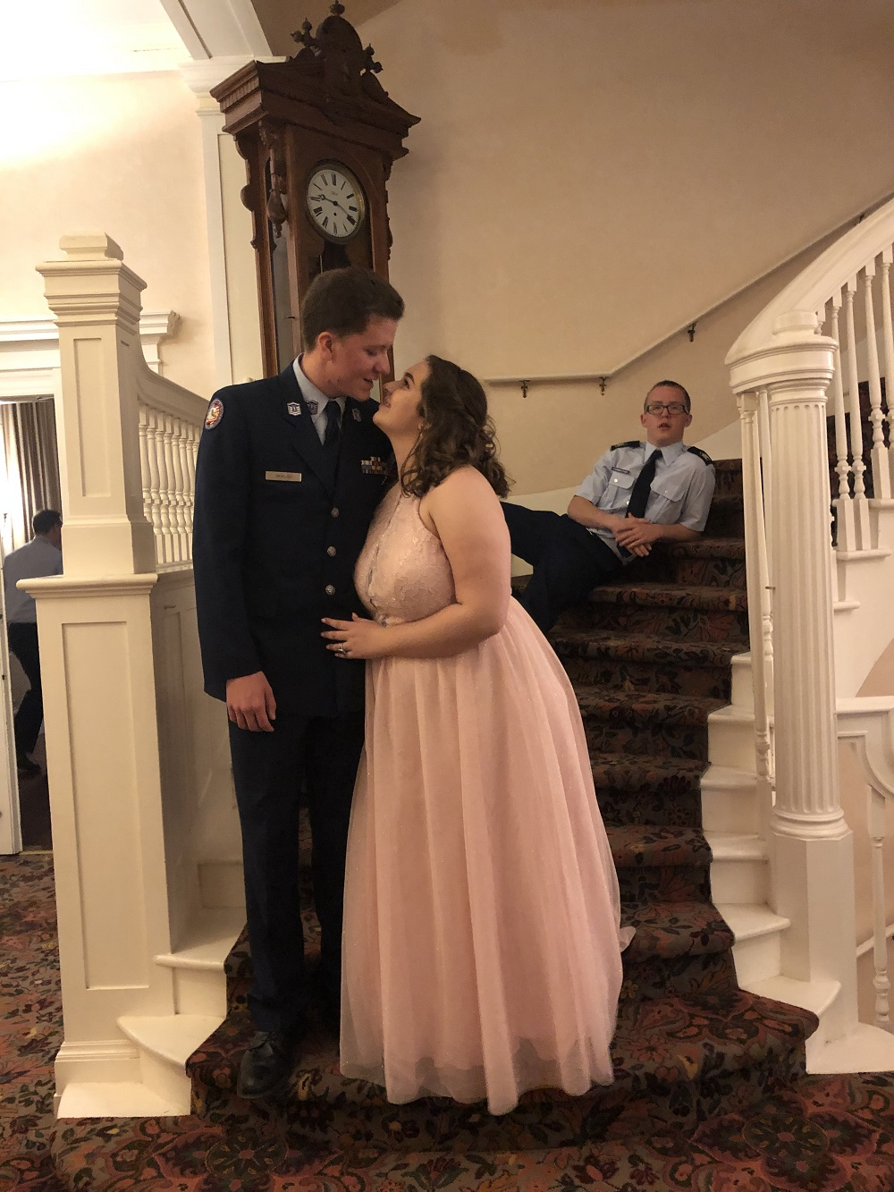 Alpha Flight Commander Master Sergeant Matt Grailich and date, Kaitlyn Roberts. With photobomb from Zander Fairbrother, Ball Royalty
