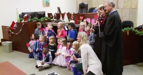 Young boy invited his entire kindergarten class to his adoption