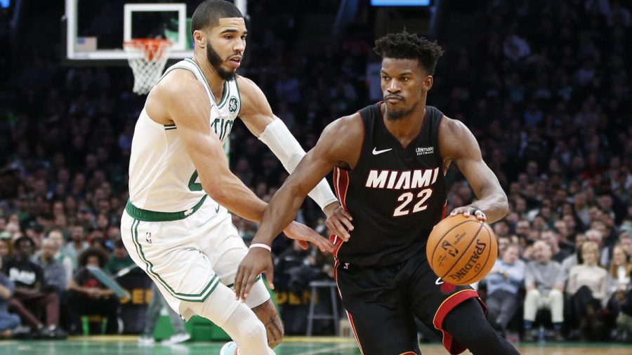 Dec 4, 2019; Boston, MA, USA; Miami Heat guard Jimmy Butler (22) is guarded by Boston Celtics forward Jayson Tatum (0) during the first half at TD Garden. Mandatory Credit: Greg M. Cooper-USA TODAY Sports